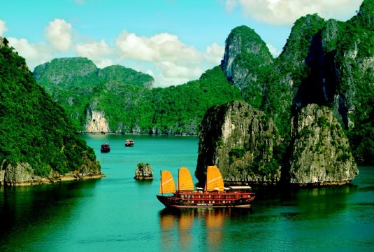 Absorb the dramatically beautiful scenery of Ha Long Bay aboard a traditional Vietnamese junk.